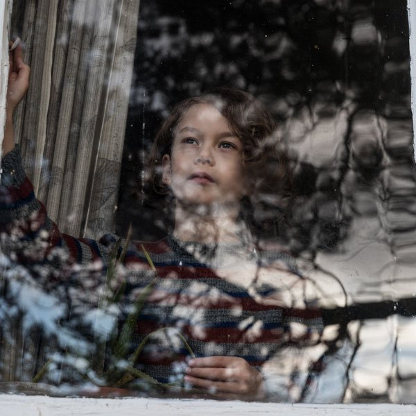 Girl in window with reflections